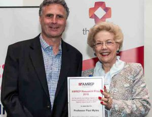Professor Andrew Forbes - receiving 2018 AMREP Research Prize for Clinical Research on behalf of Professor Paul Myles, presented by Dr Susan Alberti.
