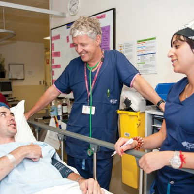 Professor Paul Myles with nurse Heidi Harrosh explains the pre-operative procedure to a patient