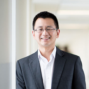 Professor Allen Cheng smiles and looks at the camera